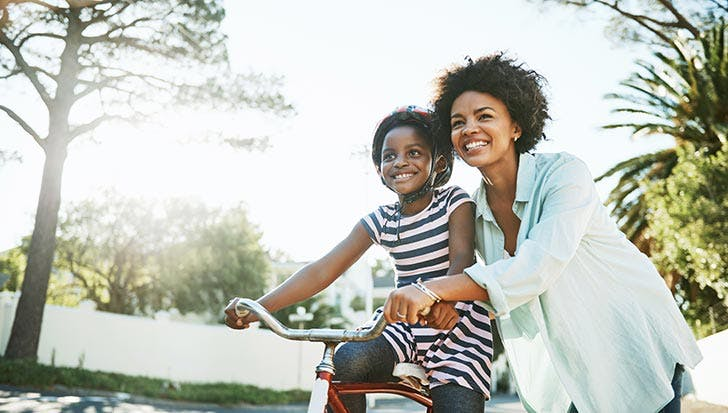 Mom and daughter riding bike