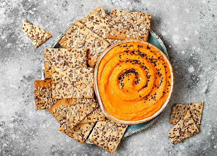 Plate of pumpkin hummus with crackers