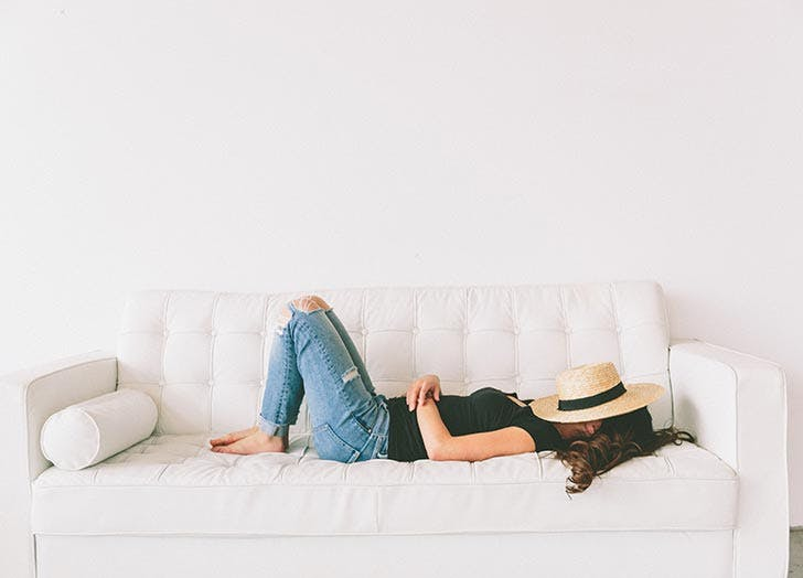 Woman relaxing and napping on couch