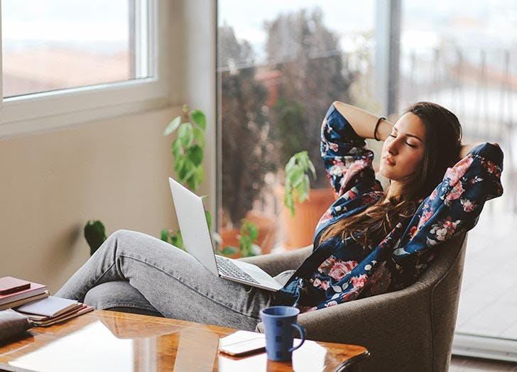 Woman relaxing at home with computer