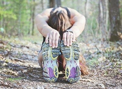 Woman stretching before run 400