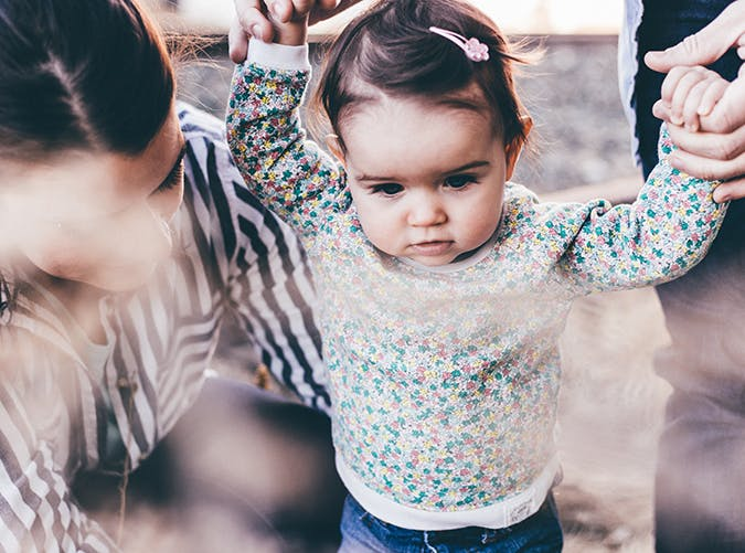 baby girl wearing a flower sweatshirt