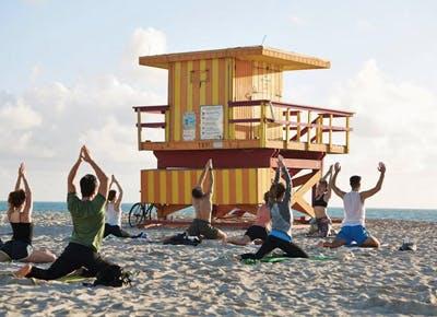 people doing yoga on beach 400