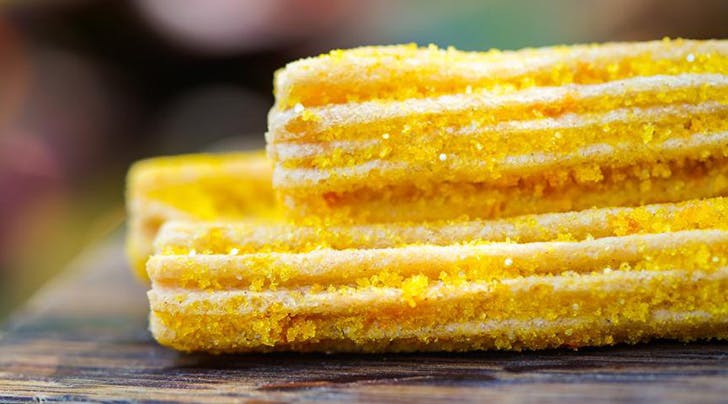 Disneyland Unveils Shimmery Pineapple Churros with Marshmallow Dipping Sauce (Because, Duh)