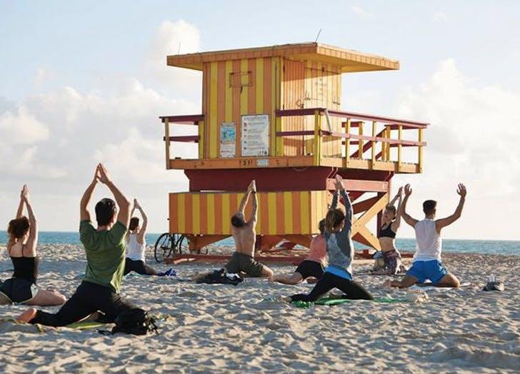 poeple doing yoga on beach list