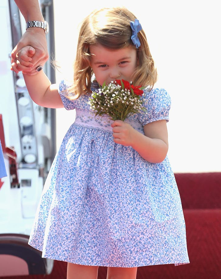 princess charlotte smelling flowers