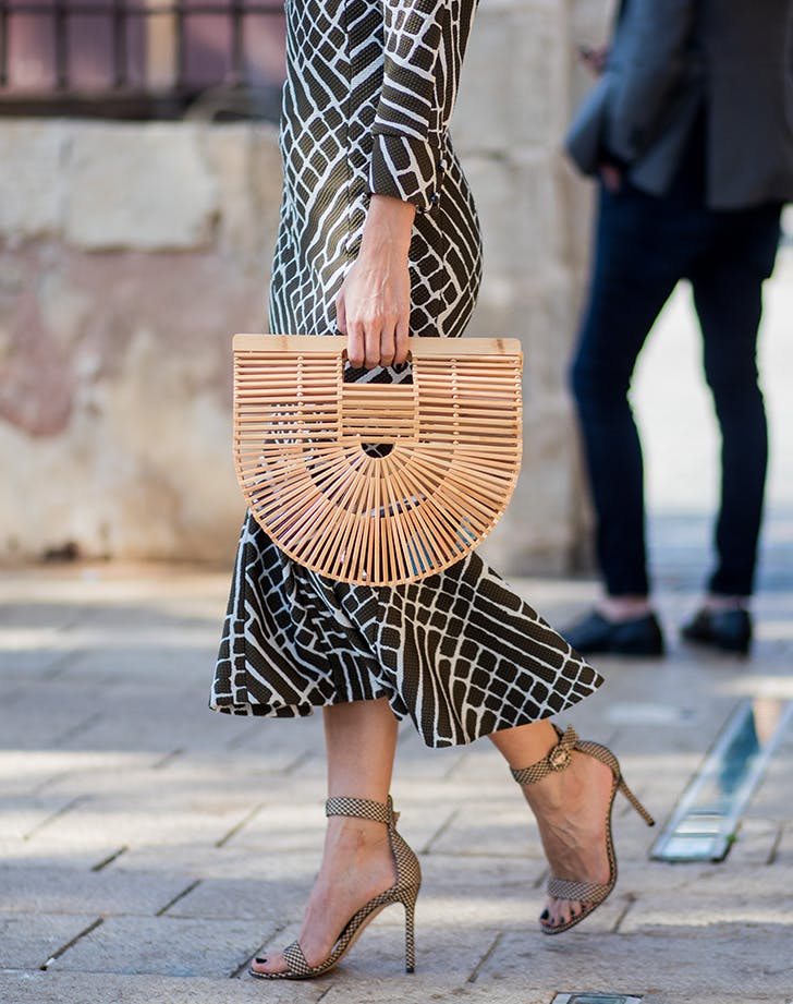 structured wooden basket bags are no longer trending