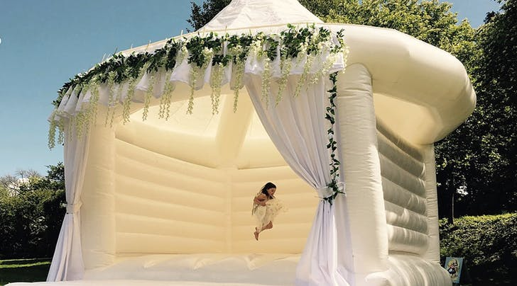 Couples Are Renting Bouncy Castles for Their Weddings, and Please (Pretty Please) Invite Us