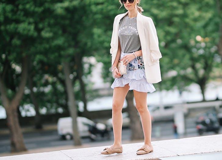 woman wearing a ruffled skirt and blazer