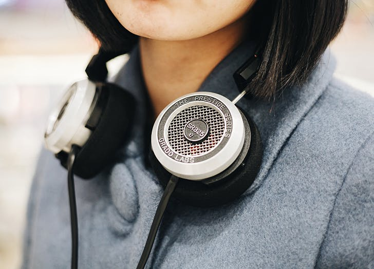 woman wearing headphones around her neck