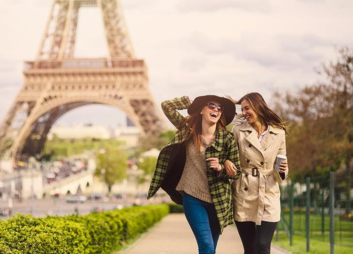 Friends walking by Eiffel Tower