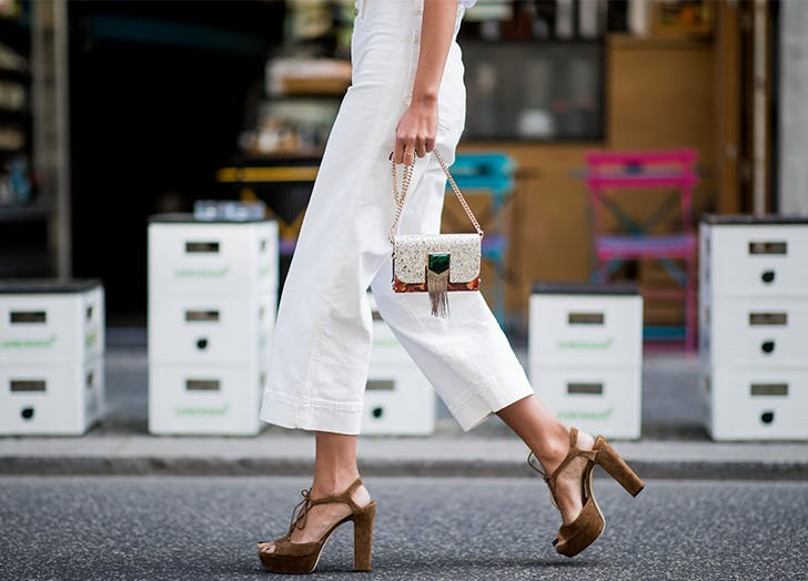 Woman in white wide leg culottes