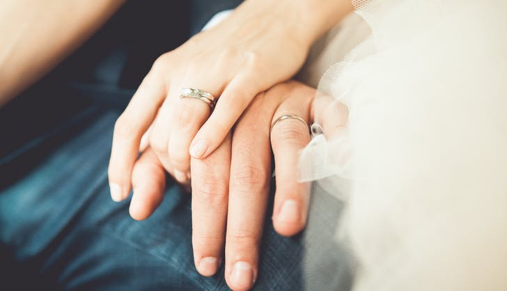 a newlywed couple s wedding rings