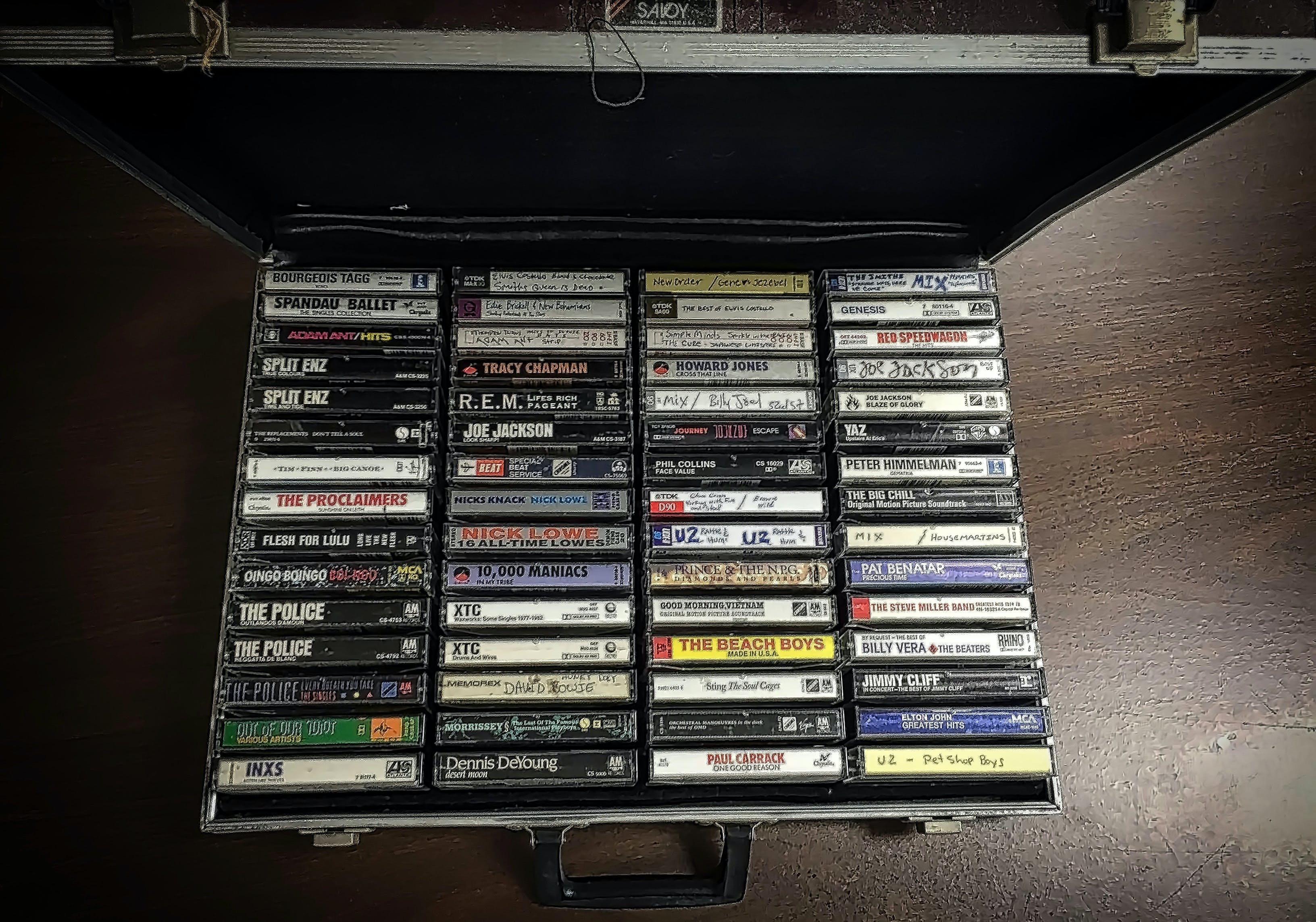 a well organized collection of cassette tapes