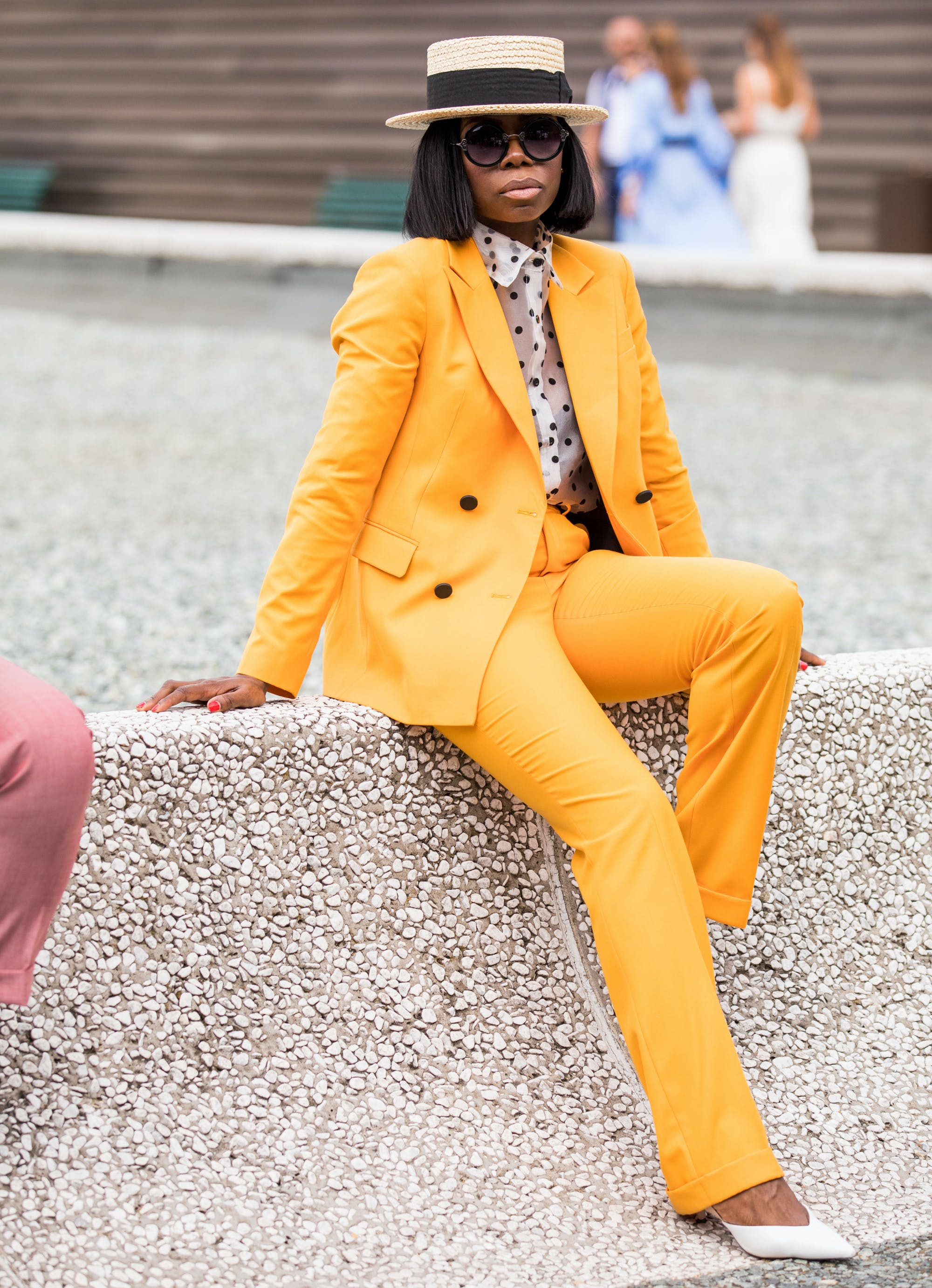 a woman wearing a bright yellow orange suit