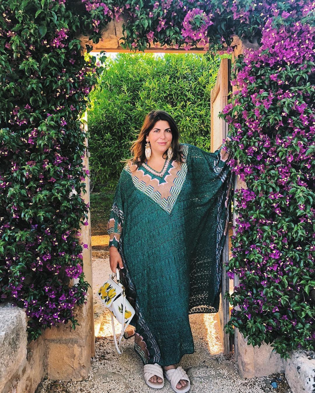 a woman wearing a glamorous caftan