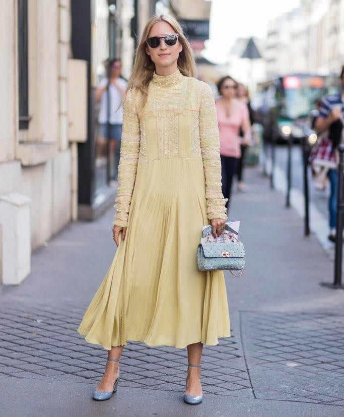 a woman wearing a long sleeve tent dress in summer
