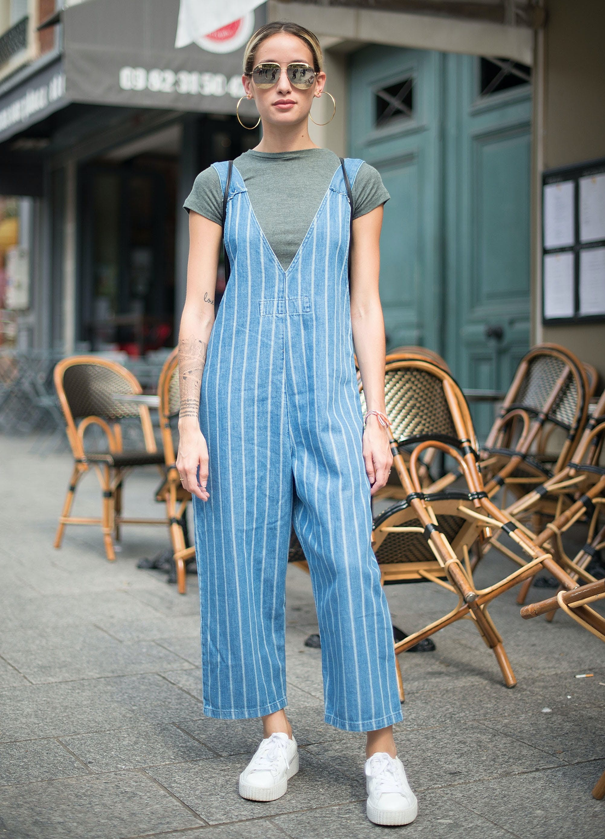 a woman wearing a loose jumpsuit