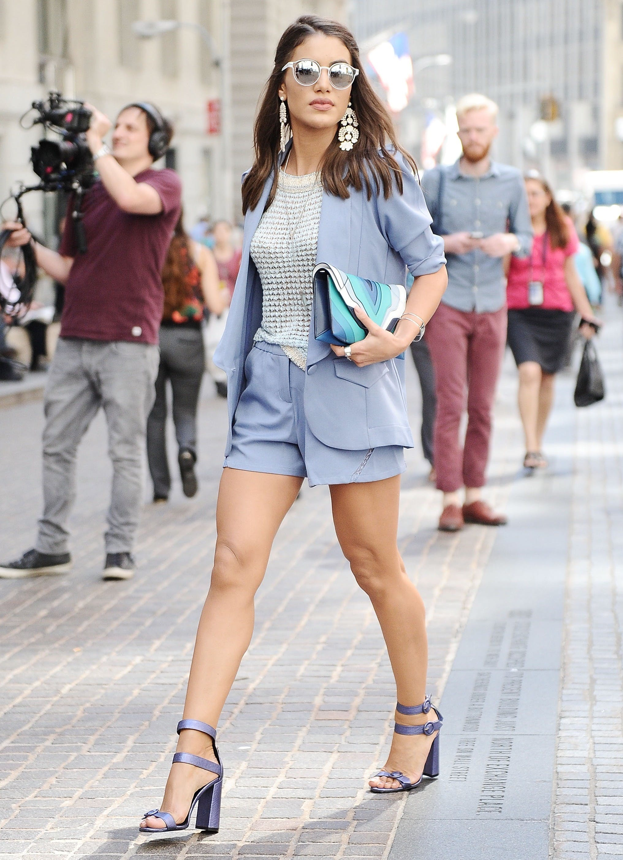 a woman wearing a shorts suit