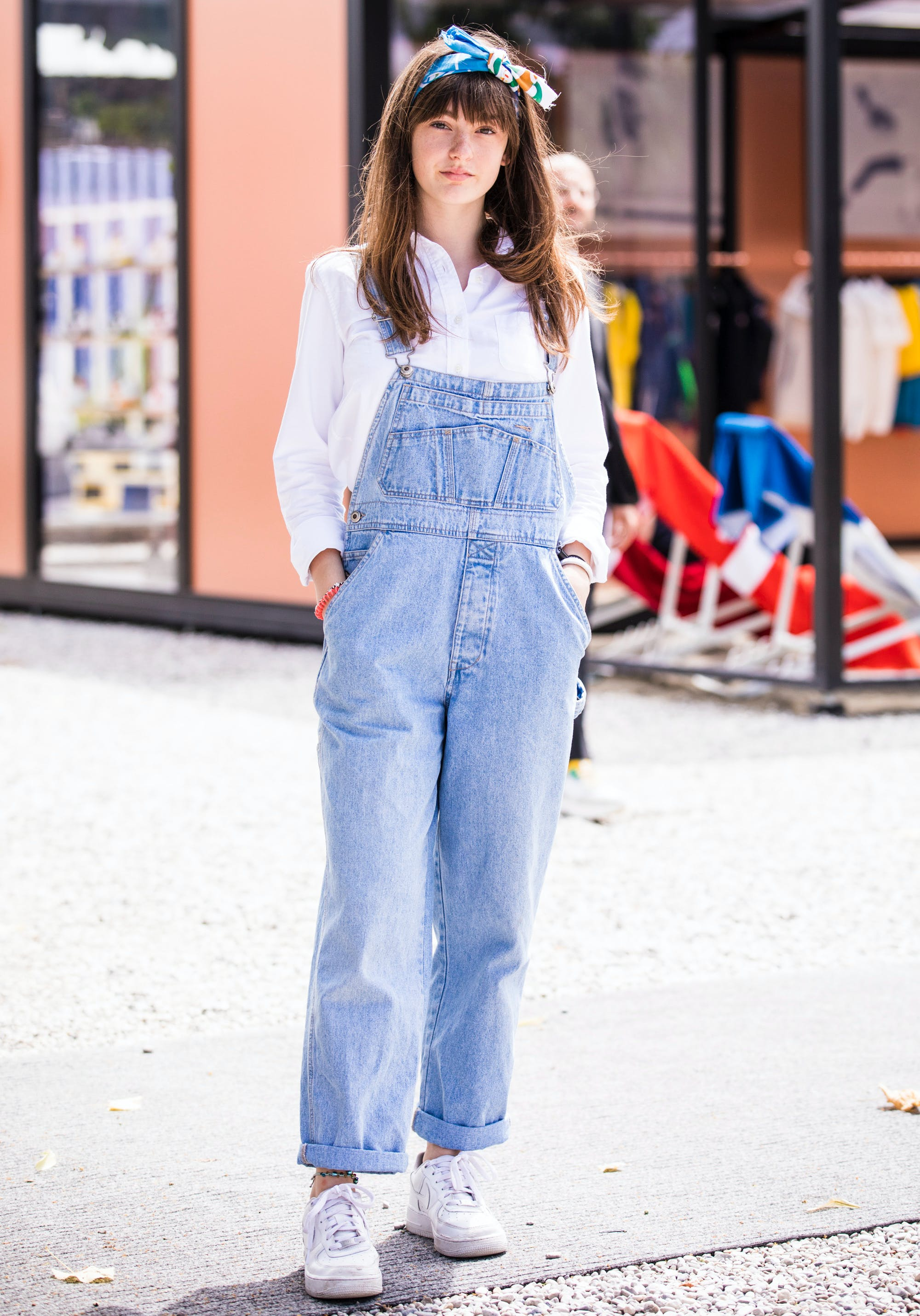 a woman wearing denim overalls