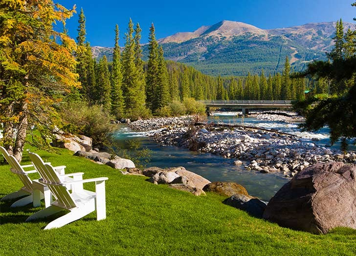 alberta canada post hotel and spa mountains chairs river