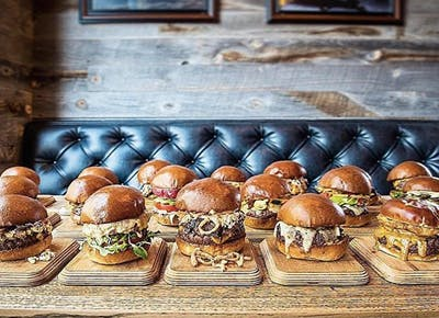 burgers on platters wood leather bench 400