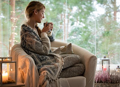 cozy woman in home weekly horoscope 400