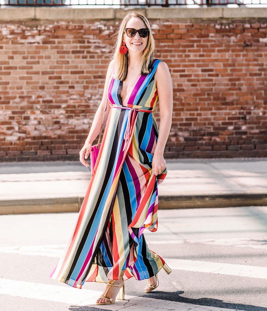 grace atwood wearing a rainbow stripe maxi dress