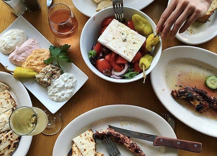 greek food plates hands