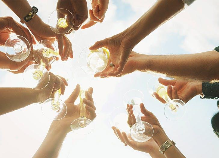 hands wine cheers
