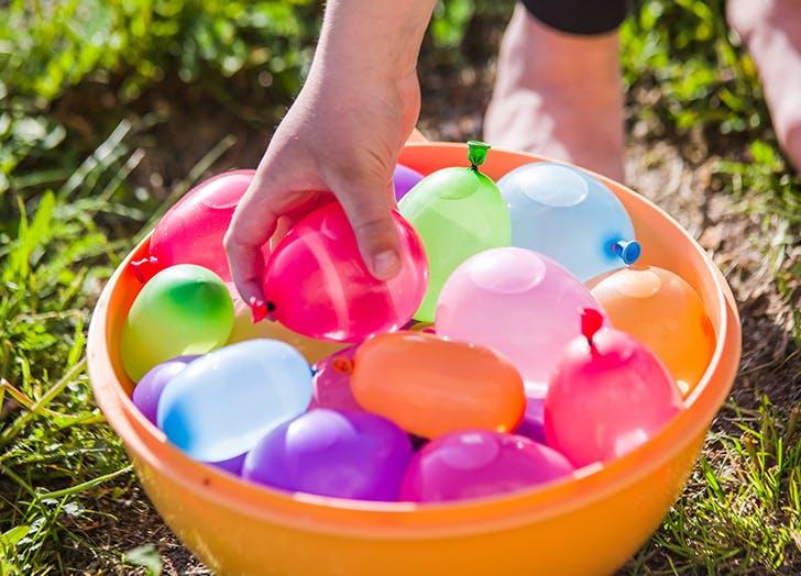 kid grabbing water balloons