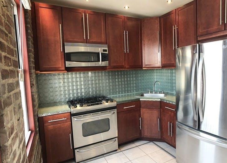 kitchen queens apartment brown cabinets