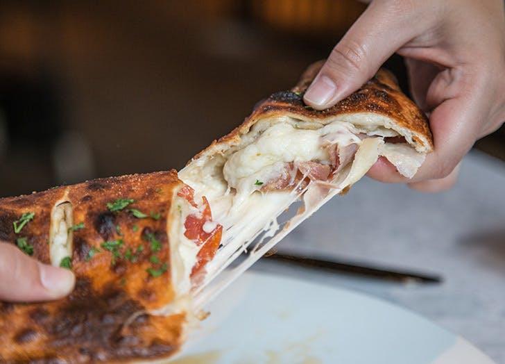 machina calzone cheese meat hands