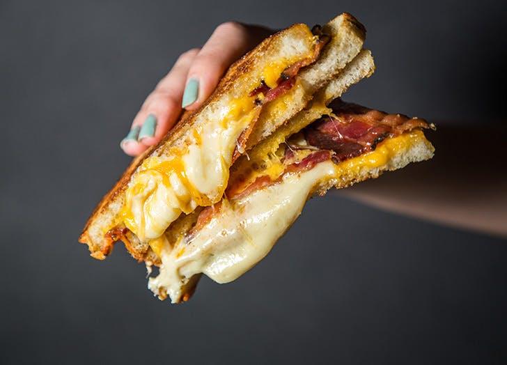 melt shop cheese bacon hands