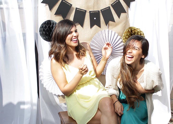 photo booth two girls laughing