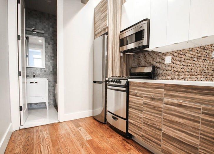 queens apartment bathroom kitchen wood floor2