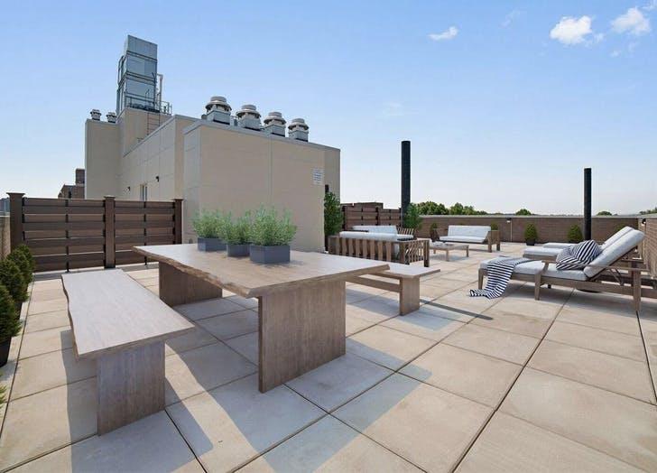 queens apartment rooftop benches beige