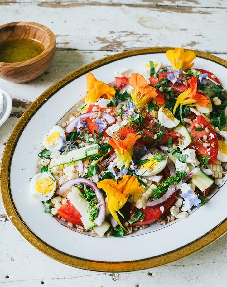 sweet corn tomato zucchini grain salad with peach dijon vinaigrette recipe