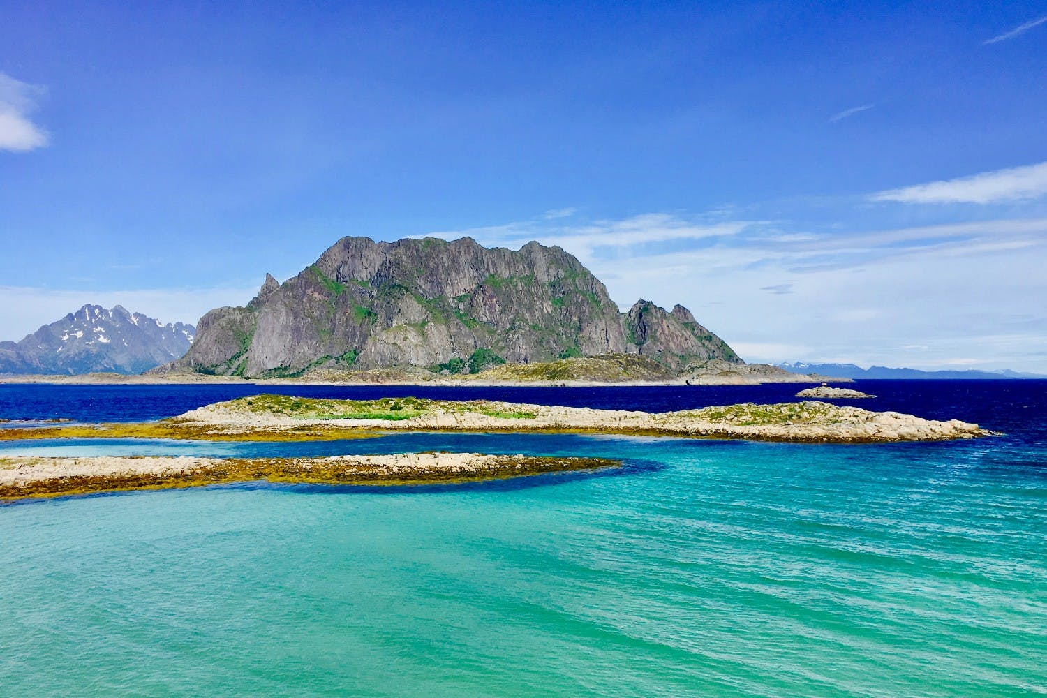 the lofoten islands in norway with crystal blue waters