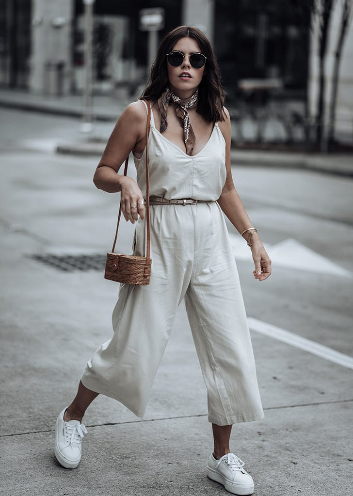 tiffany jais wearing a belted jumpsuit
