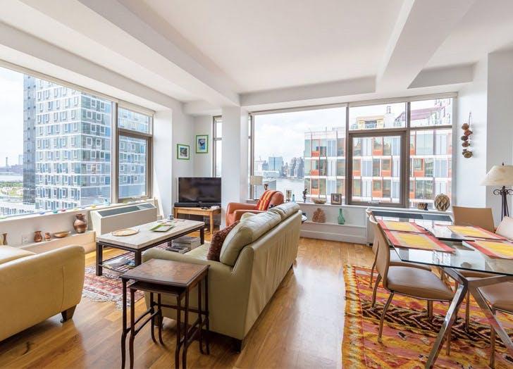two bedroom LIC queens wood floors couch windows