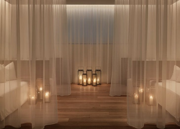 two beds candles drapes wood