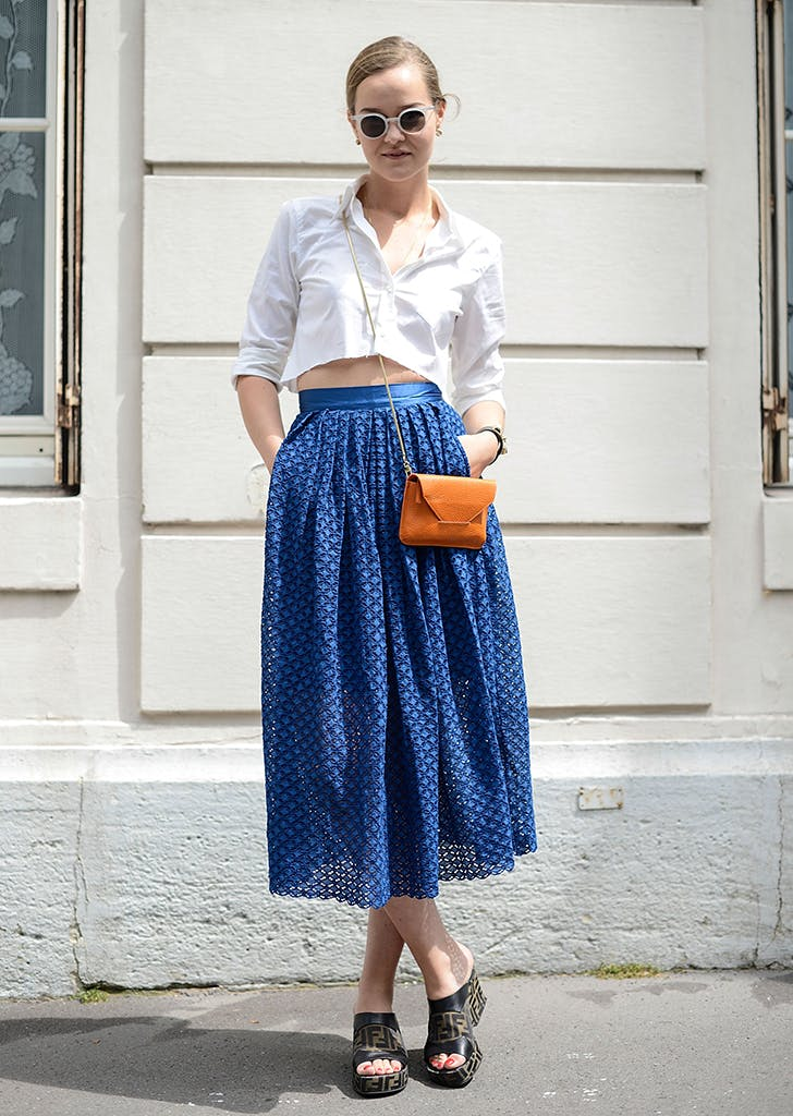 woman wearing a crop top and full skirt