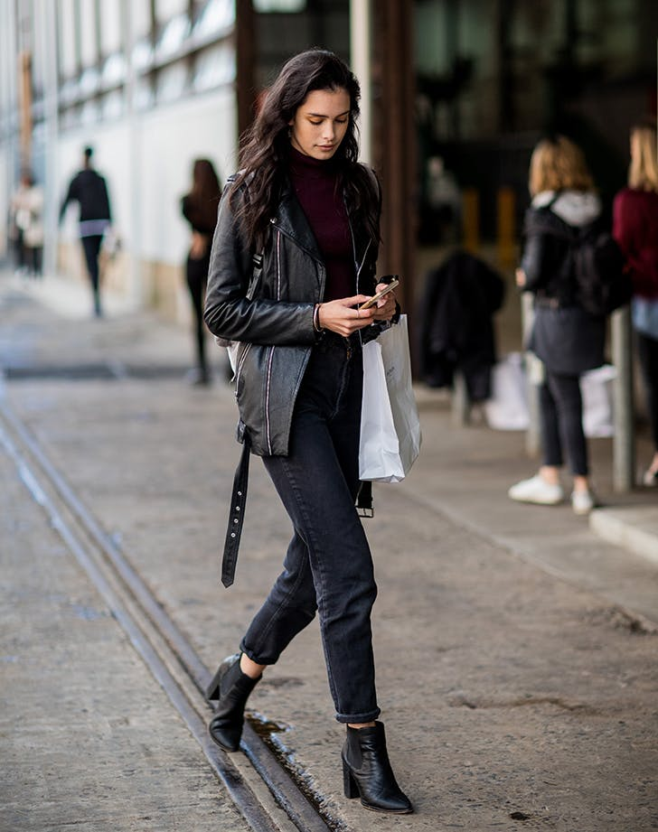 woman wearing black pants black jacket black boots