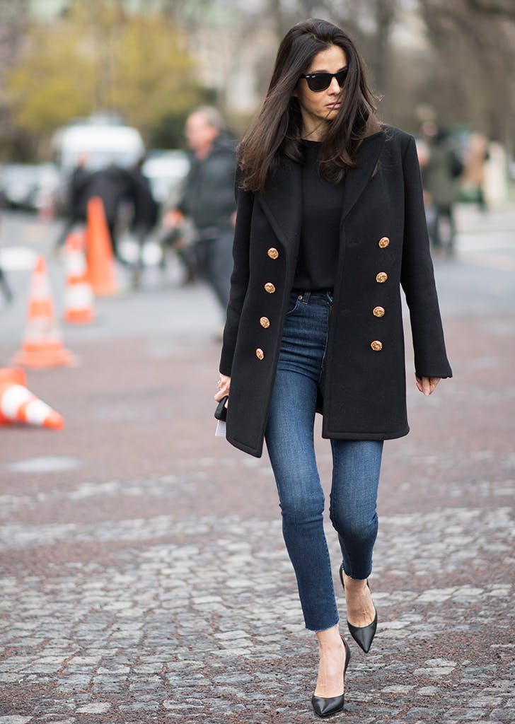 woman wearing blazer and dark jeans