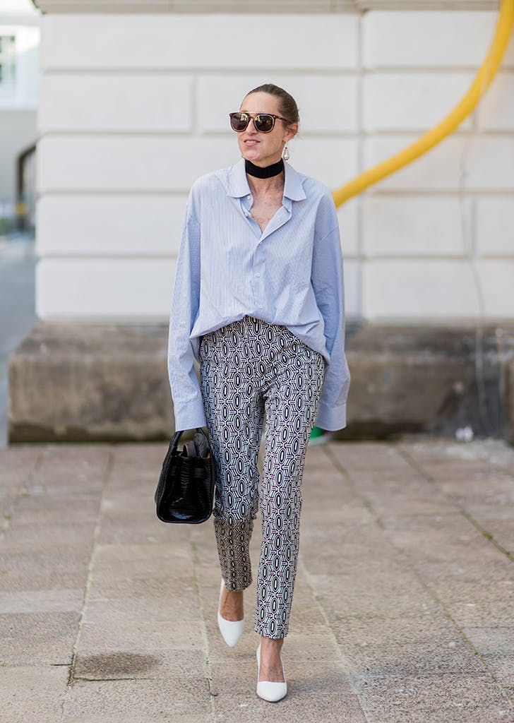 woman wearing button down and printed pants