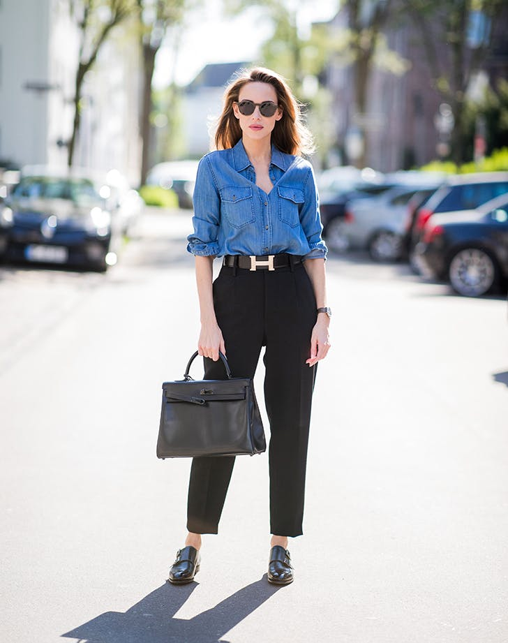 woman wearing chambray shirt and black pants