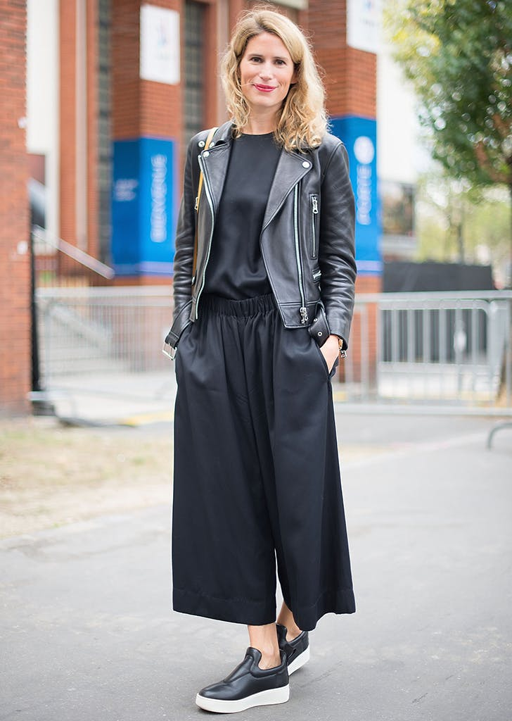 woman wearing culottes and moto jacket