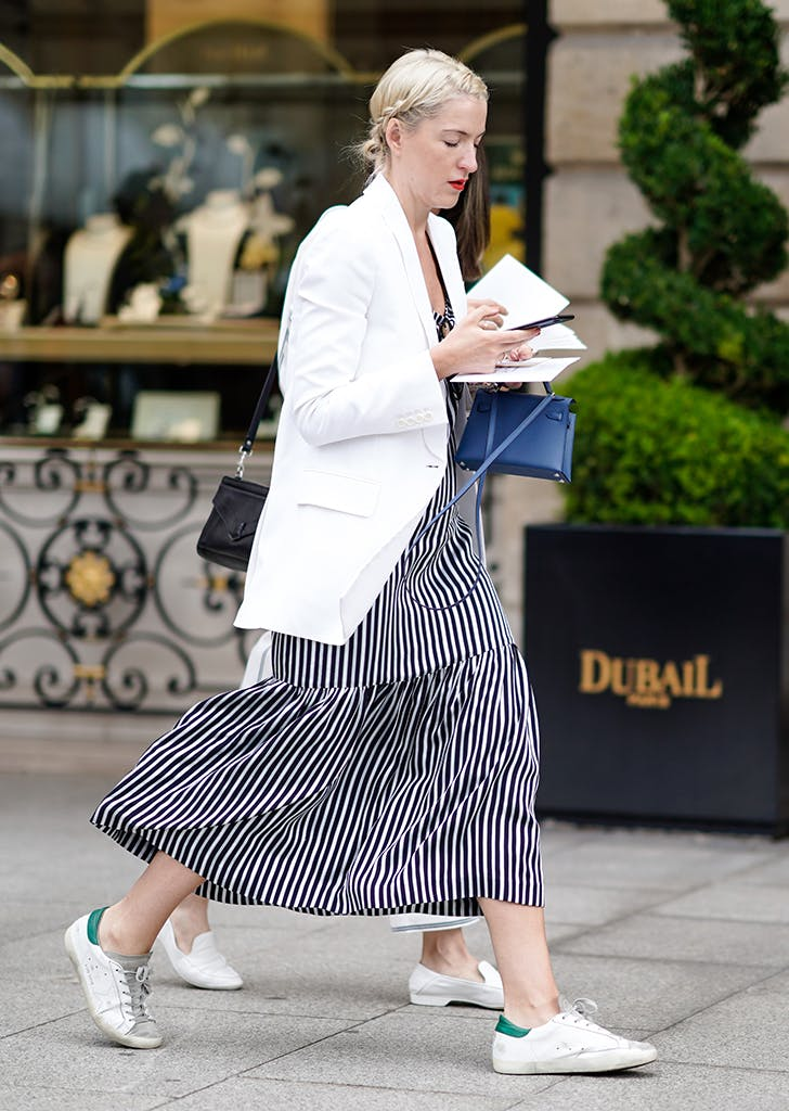 woman wearing dress blazer and sneakers