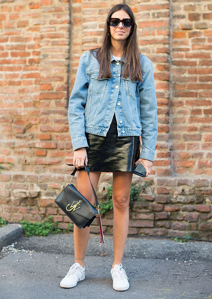 woman wearing jean jacket and miniskirt